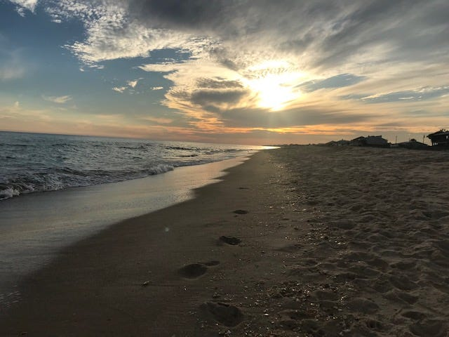 Sunset at St George Island with a panorama of art in the skies that will never be duplicated.  Sunsets can signify the closure of certain events in our lives.
