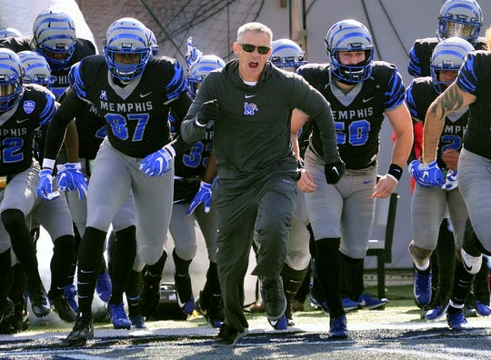 Nov 10, 2018; Memphis, TN, USA; Memphis Tigers head coach Mike Norvell runs on to the field against the Tulsa Golden Hurricane before a game at Liberty Bowl Memorial Stadium. Mandatory Credit: Justin Ford-USA TODAY Sports