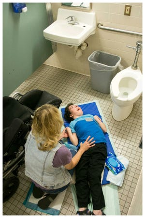 A bill before the Florida Legislature would mandate adult changing tables in public rest rooms