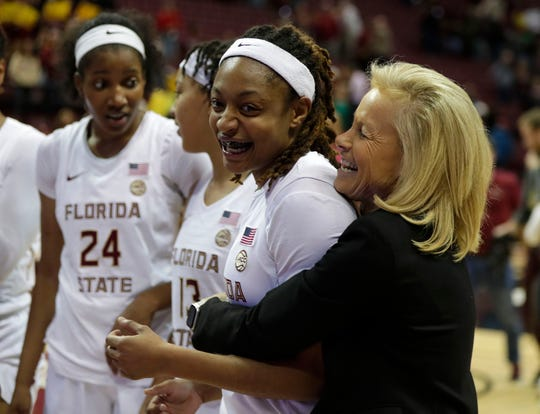 Florida State Seminoles head coach Sue Semrau bear hugs Florida State Seminoles guard Nicki Ekhomu (12) after the team's hard fought victory. The Florida State Seminoles beat the Michigan State Spartans 78-68 on Thursday, Dec. 5, 2019.