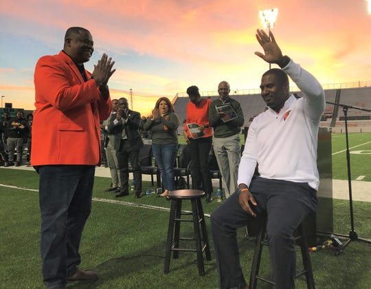 FAMU football head coach Willie Simmons (right) waves to the crowd following a standing ovation during the year-end celebration at Bragg Memorial Stadium on Thursday, Dec. 4, 2019.