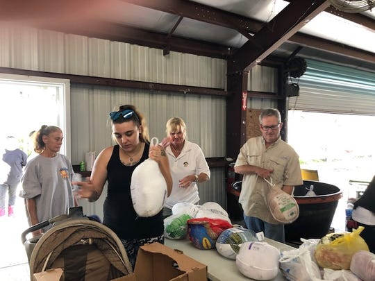 Volunteers helped distribute more than 300 turkeys at the annual Thanksgiving Food giveaway at Operation Hope in Fellsmere in November 2019.