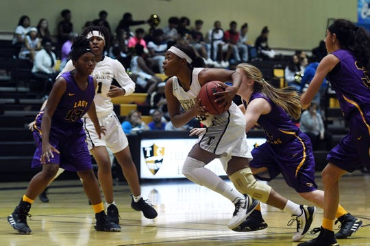 Treasure Coast High School's Brianna Houston makes her way to the basket through the Fort Pierce Central High School defense on Thursday. Dec. 5, 2019, during a District 9-7A game in Port St. Lucie. Treasure Coast won 71-24.