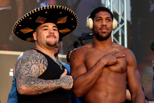 "Heavyweight boxers Anthony Joshua of Britain, right, and Andy Ruiz Jr. of Mexico pose during a weigh-in at Faisaliah Center, in Riyadh, Saudi Arabia, Friday, Dec. 6, 2019. The first ever heavyweight title fight in the Middle East, has been called the ""Clash on the Dunes."" Will take place at the Diriyah Arena on Saturday."