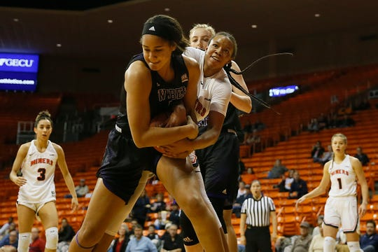 UTEP's Ariona Gill goes against Weber State defense during the game Thursday, Dec. 5, at the Don Haskins Center in El Paso.