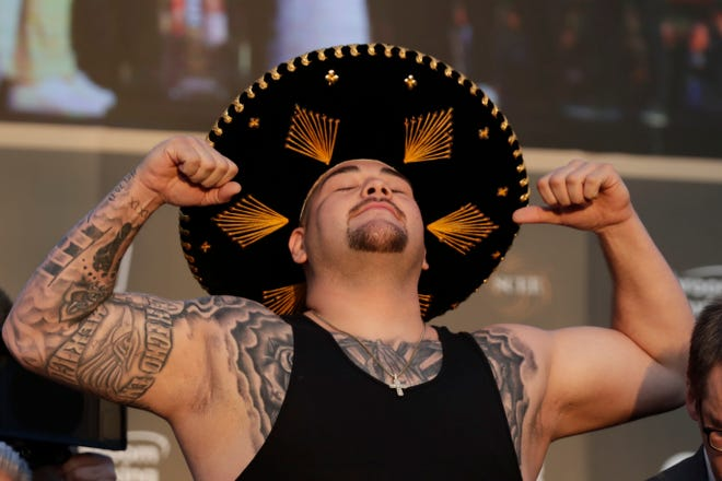 """Heavyweight boxer Andy Ruiz Jr. poses during a weigh-in at Faisaliah Center in Riyadh, Saudi Arabia, Friday, Dec. 6, 2019. The first ever heavyweight title fight in the Middle East has been called the """"Clash on the Dunes."""" It will take place at the Diriyah Arena on Saturday."""