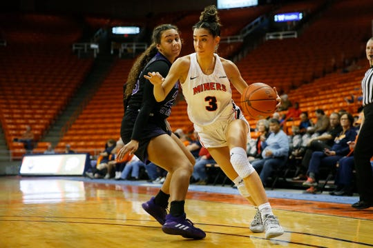 UTEP's Katia Gallegos goes against Weber State defense during the game Thursday, Dec. 5, at the Don Haskins Center in El Paso.
