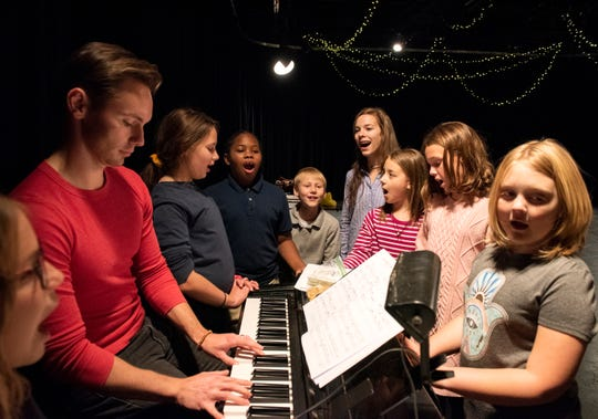 Rachel Johnson, middle right, sings with children in the Spartanburg Youth Theatre during a recent rehearsal for the class' performance of Matilda.