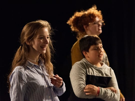 Rachel Johnson, left, participates warm-up exercises with children at the Spartanburg Youth Theatre.