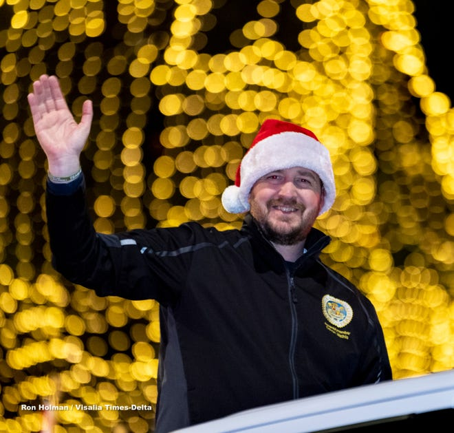 Assemblyman Devon Mathis rides with the Brotherhood of Veterans float during the Tulare Christmas Parade on Thursday, December 5, 2019.