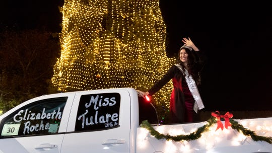 Miss Tulare Elizabeth Rocha waves to parade spectators during the Tulare Christmas Parade on Thursday, December 5, 2019.