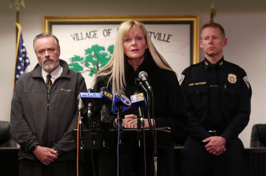 Pleasantville School Superintendent Mary Fox-Alter speaks as Pleasantville Mayor Peter Scherer speaks and Police Chief Erik Grutzner look on during a news conference on the death of a family of four in Pleasantville Dec. 6, 2019.