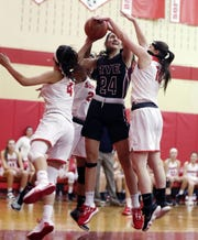 Rye's Amanda Latkany (24) is surrounded by Somers defenders as she goes up for a shot during girls basketball action at Somers High School Dec. 5, 2019. Rye won the game 54-35.