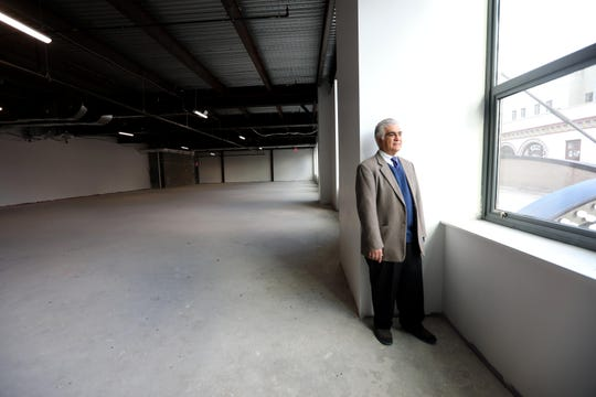 Al Cordero Casal, chairman of the Venezuelan American Endowment for the Arts, stands inside what used to be the old Loews Theater in New Rochelle Dec. 5, 2019. His organization, known as VAEA, is planning on turning the space into a multi-use facility that will include a cafe, theater space, and a gallery.