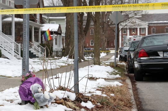 Teddy bear and flowers are left under police tape on the corner near the home at 57 Romer Ave in Pleasantville where a family of four were found dead Dec. 6, 2019.