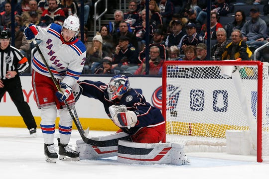 Dec 5, 2019; Columbus, OH, USA; New York Rangers center Brett Howden (21) screens Columbus Blue Jackets goalie Joonas Korpisalo (70) during the second period at Nationwide Arena. Mandatory Credit: Russell LaBounty-USA TODAY Sports