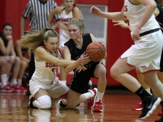 From left, Somers' Amy Lasher (1)  and Rye's Mara Ball (5) battle for a loose ball during girls basketball action at Somers High School Dec. 5, 2019. Rye won the game 54-35.