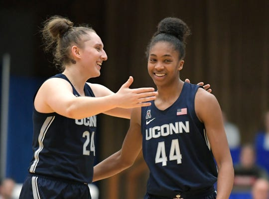 Connecticut guards Aubrey Griffin (44) and Anna Makurat (24) celebrate after Connecticut defeated Seton Hall 92-78 in an NCAA college basketball game Thursday, Dec. 5, 2019, in South Orange, N.J. (AP Photo/Bill Kostroun)