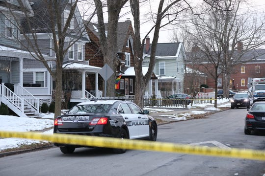A Pleasantville police car travels down Romer Avenue on Friday morning, Dec. 6, 2019, after four people were found dead in a home on the street on Thursday.