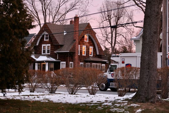 A Westchester County Police truck sits near 57 Romer Ave. in  Pleasantville on Friday, Dec. 6, 2019 after four people were found dead at the house.