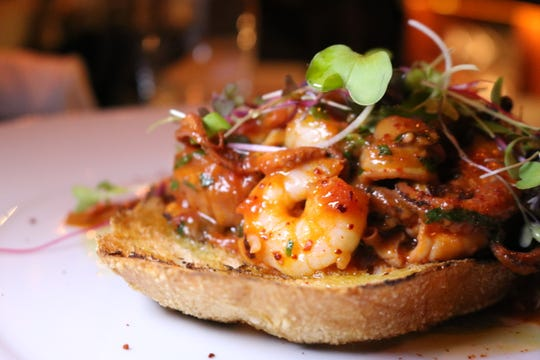 Seafood fra diavolo toast from L'inzio in Ardsley featuring clams, octopus, calamari, and shrimp.