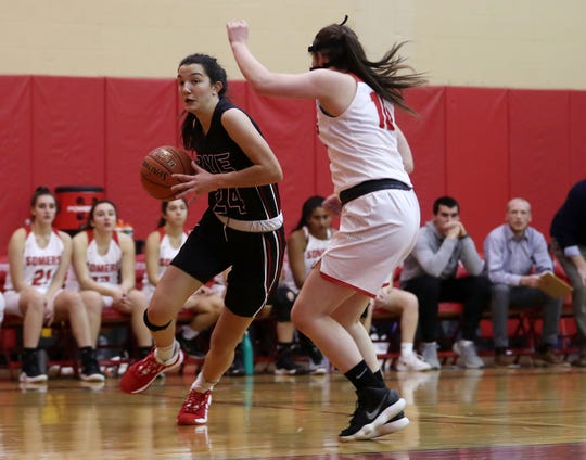 Rye's Amanda Latkany (24) drives to the basket against Somers during girls basketball action at Somers High School Dec. 5, 2019. Rye won the game 54-35.