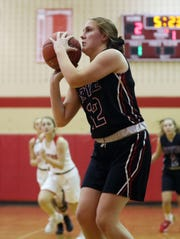Rye's Teaghan Flaherty (12) puts up a shot against Somers during girls basketball action at Somers High School Dec. 5, 2019. Rye won the game 54-35.