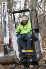 Ben Appleby, owner of Linear Active, LLC, works on a mountain bike trail in Wayne National Forest near Chauncey.