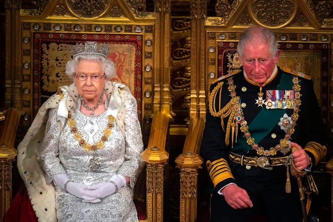 Queen Elizabeth II with Prince Charles, Prince of Wales on the Sovereign's throne to deliver the Queen's Speech at the State Opening of Parliament in in London on Oct. 14, 2019.
