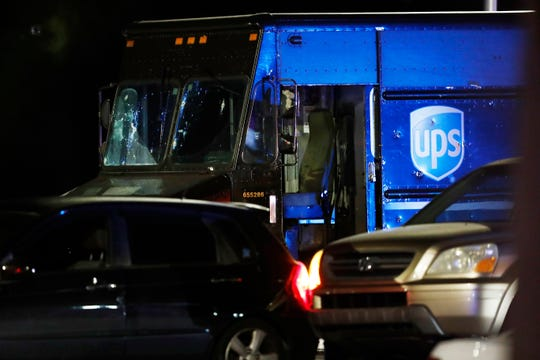 Authorities investigate the scene of a shooting Thursday, Dec. 5, 2019, in Miramar, Fla. Four people, including a UPS driver, were killed Thursday after robbers stole the driver's truck and led police on a chase that ended in gunfire at a busy Florida intersection during rush hour, the FBI said.
