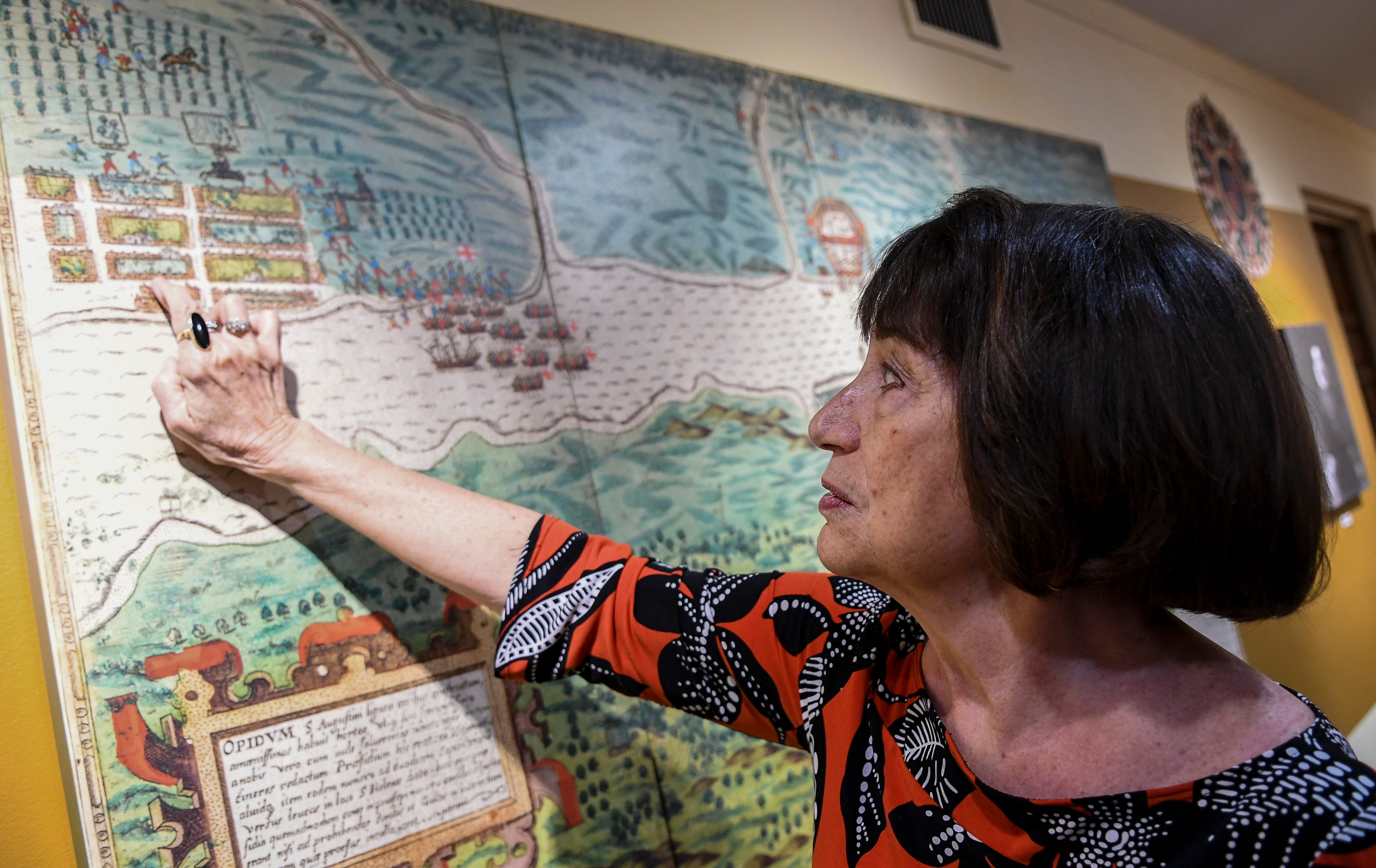 Historian Susan Parker points to a map of early St. Augustine on the wall at the St. Augustine Historical Society.
