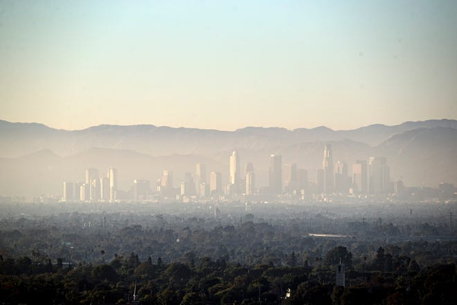 "A layer of smog covers downtown Los Angeles on August 14, 2019. Los Angeles was the USA's smoggiest city again, according to the new ""State of the Air"" report from the American Lung Association."