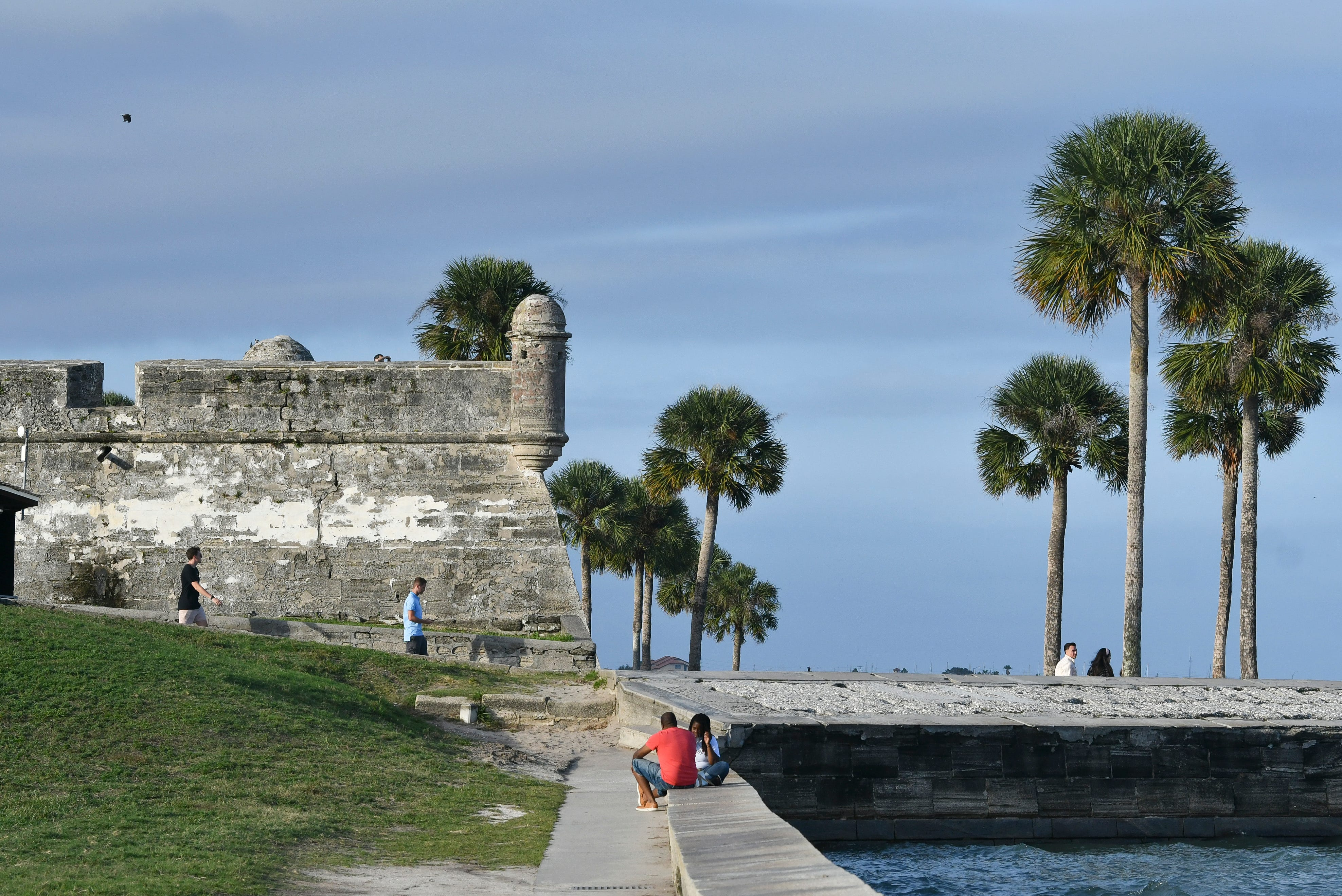 Tourists wander the grounds of the Castillo de San Marcos, the oldest masonry fort in the U.S.