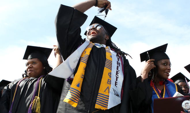Students ceremoniously switch their tassels to the left side in Durham, North Carolina, in May 2012.
