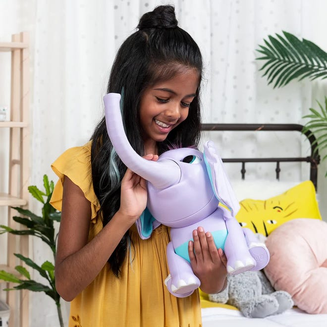 Spin Master Wildluvs Juno My Baby Elephant is a starter personal robot companion with more than 150 sounds and lifelike movements.