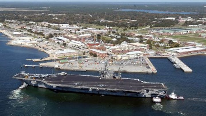 This US Navy file handout photo shows the USS John F. Kennedy arriving at the Naval Air Station in Pensacola, Florida, on March 18, 2004. US Navy is reporting an active shooter at the Air Station on Dec. 6, 2019. there are reports of injuries.