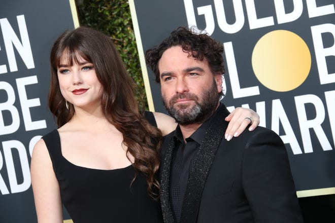 Alaina Meyer, left and Johnny Galecki arrive at the 76th Golden Globe Awards at the Beverly Hilton.