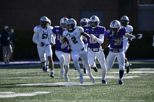 Monmouth's Lonnie Moore (2) takes a kickoff back 93 yards for a touchdown against James Madison.