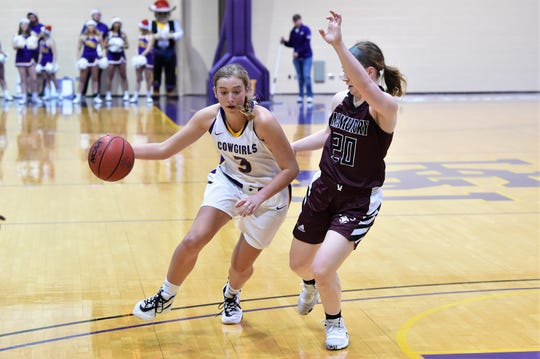 Hardin-Simmons' Parris Parmer (3) drives to the basket against McMurry's Sarah Doherty (20) during the ASC opener at the Mabee Complex. Parmer has started all nine conference games, averaging 12.6 points and 7.3 rebounds in league play.