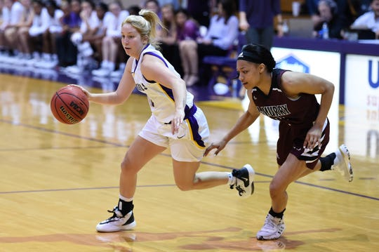 Hardin-Simmons' Brittany Schnabel (5) dribbles past a McMurry defender during the ASC opener at the Mabee Complex on Saturday. Schnabel is one of several new Cowgirls who got their first conference victory over the weekend.