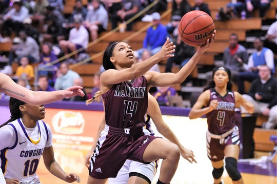 McMurry's Jada Handley (14) goes up for a shot during the ASC opener against Hardin-Simmons at the Mabee Complex on Saturday. Handley is one of 11 freshmen who played in the game for the War Hawks.