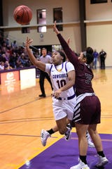 HSU's Taylor Gaffney (10) gets fouled taking shot during the ASC opener against McMurry at the Mabee Complex on Saturday. Gaffney helped lead the Cowgirls early in the season, winning the first ASC West Player of the Week award of the season.