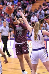 McMurry's Skyler Reyna (34) adjusts to shoot during the ASC opener against Hardin-Simmons at the Mabee Complex on Saturday, Dec. 7, 2019. The Cowgirls picked up the 71-62 victory.