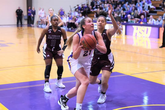 Hardin-Simmons' Kaitlyn Ellis (21) against McMurry during the ASC opener at the Mabee Complex on Saturday. Ellis scored a team-high 14 points and added six rebounds in the 71-62 win.