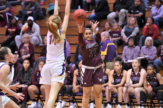 McMurry's Skyler Reyna (34) takes a 3-pointer against Hardin-Simmons earlier this season. Reyna enters her final game with 1,432 points and 926 rebounds in her career.