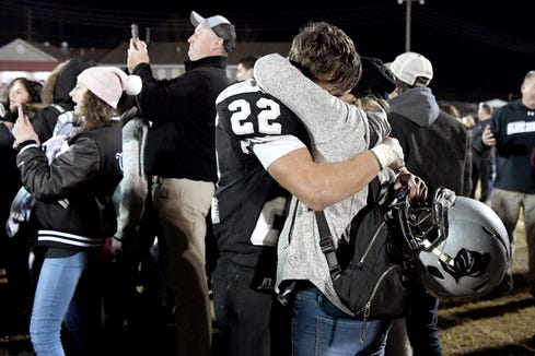 Robbinsville senior Rylee Anderson holds his mom, Diane, tight in an emotional hug after the Black Knights defeated Thomas Jefferson 28-14 in the 1A West Region final in Robbinsville on Dec. 6, 2019. The Black Knights advanced to the state final game.