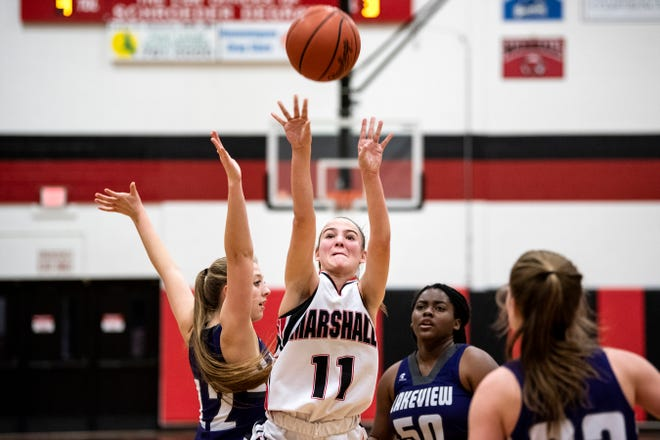 Marshall sophomore Mallory Tucker (11) shoots a basket on Friday, Dec. 6, 2019 in Marshall, Mich. Marshall defeated Lakeview 59-45.