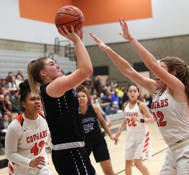 Central Kitsap's Jada Kopp (left) tries to block the shot of Olympic's Kayla Brehmer (right) during the second half of their game at Central Kitsap High School on Friday, December 6, 2019.