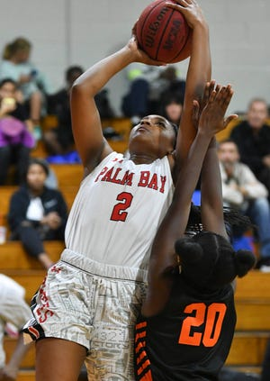 Mikyla Tolivert of Palm Bay shoots over Trisann Gordon of Lincoln Park Academy during a game in Melbourne
