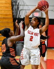 Palm Bay's Mikyla Tolivert grabs a rebound from Trisann Gordon of Lincoln Park Academy during a game in Melbourne.